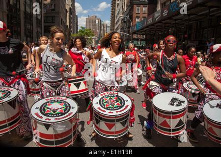 Batala NYC is an all women's Afro-Brazilian Samba Reggae drumming band. Here seen at the NYC Dance Parade. - Stock Photo