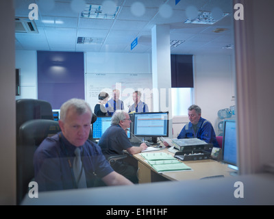 Office meeting in nuclear power station - Stock Photo