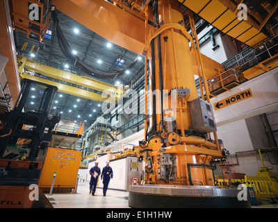 Charger machine in reactor hall of nuclear power station - Stock Photo