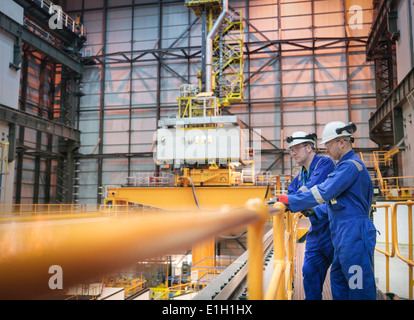 Engineers inspecting reactor hall in nuclear power station - Stock Photo