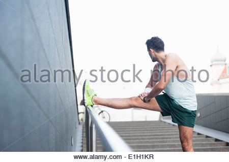 Jogger stretching - Stock Photo