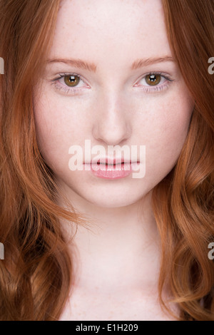 Close up portrait of young woman, looking at camera - Stock Photo