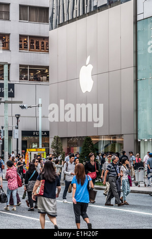 Shoppers wander the streets of Ginza in Tokyo, Japan. - Stock Photo