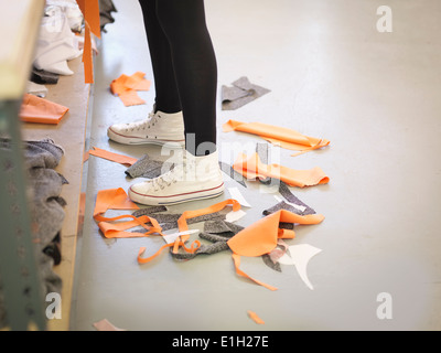 Off-cut material on floor in fashion design studio - Stock Photo