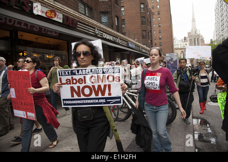 New Yorkers march in world wide day of protest against the Monsanto Corp. and its attempt to force GM foods on people. - Stock Photo