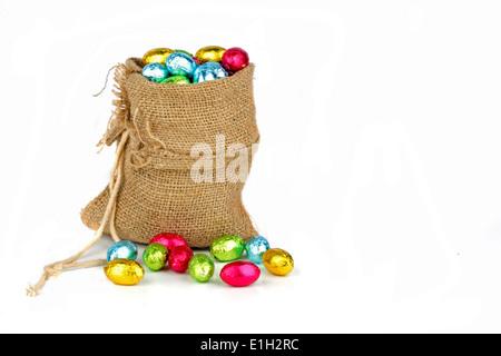 Bag full of easter chocolate eggs - Stock Photo
