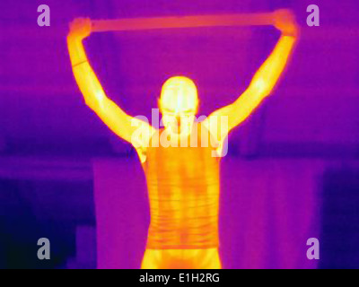 Thermal image of male athlete training with a metal bar - Stock Photo