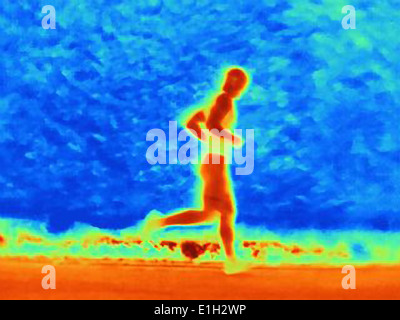 Thermal photograph of young male athlete running. The image shows the heat of the muscles - Stock Photo