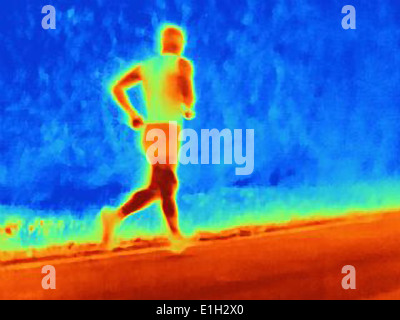 Rear view thermal photograph of young male athlete running. The image shows the heat of the muscles - Stock Photo