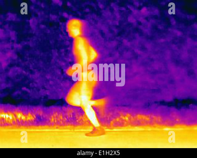 Side view thermal photograph of young male athlete running. The image shows the heat of the muscles - Stock Photo
