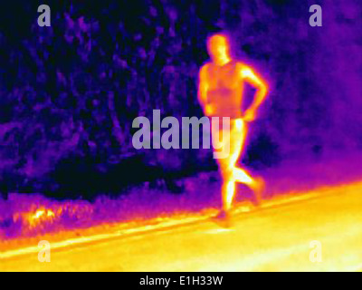 Front view thermal photograph of young male athlete running. The image shows the heat of the muscles - Stock Photo