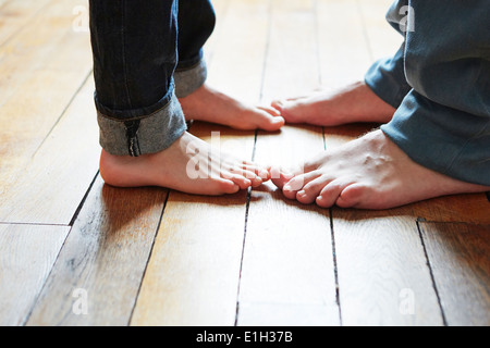 Father and son playing games with feet - Stock Photo