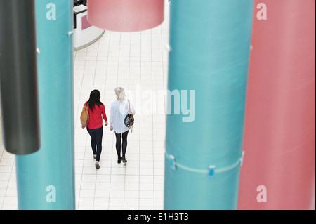 Two young women walking, high angle - Stock Photo