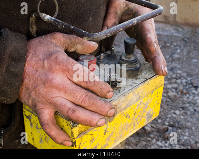 self building house, pouring floor slab, hands of man operating concrete pump remote control - Stock Photo