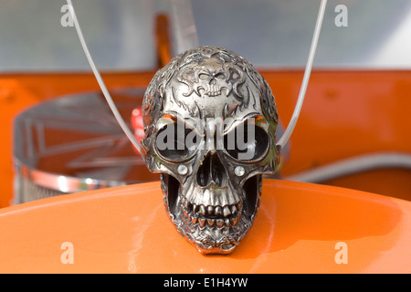 Pewter Skull Hood Ornament on a Volkswagen Beetle - Stock Photo