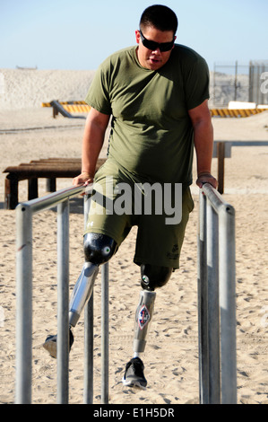 A wounded U.S Service member assigned to Naval Medical Center San Diego participates in the obstacle course at the Naval Specia