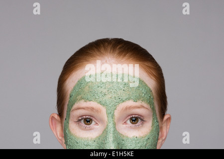 Cropped image of young woman wearing face mask - Stock Photo