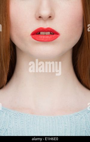 Cropped image of young woman's lips - Stock Photo