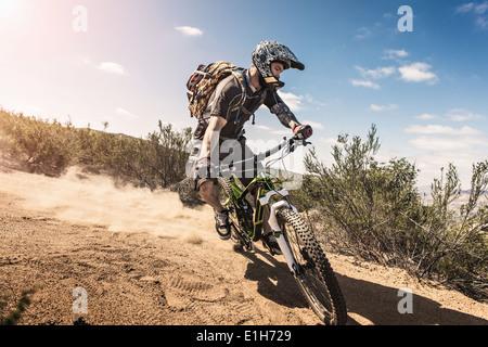 Mountain biker riding downhill - Stock Photo