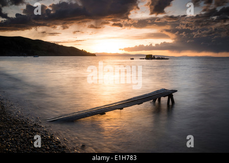 Pier at sunset, Copacabana, Lake Titicaca, Bolivia - Stock Photo