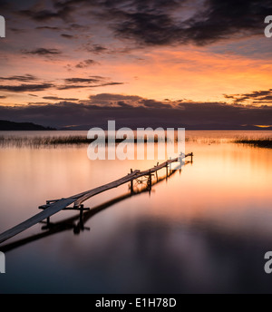 Sunset and pier, Copacabana, Lake Titicaca, Bolivia - Stock Photo
