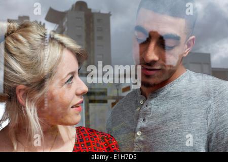 Young couple through window - Stock Photo