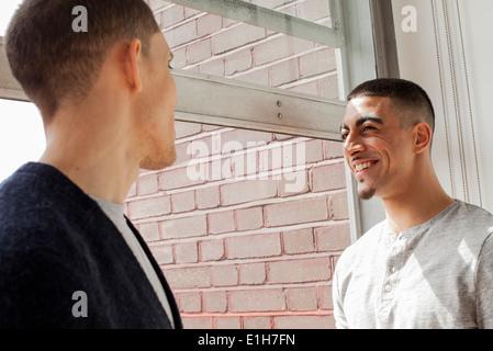 Young men having conversation - Stock Photo