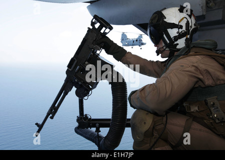 U. S. Marine Corps Gunnery Sgt. Josh Wallace, a crew chief with Marine Medium Helicopter (HMM) Squadron 268, 11th - Stock Photo