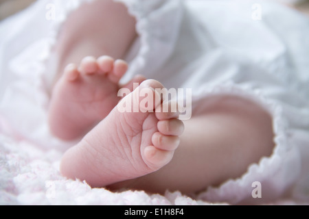 Close up of baby girl's feet - Stock Photo