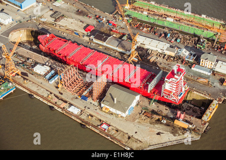 Ship being built in a dry dock - Stock Photo