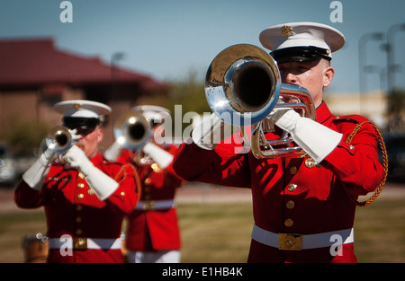 U.S. Marine Corps Sgt. Philip Jones, a bugler assigned to the Drum and Bugle Corps, performs during a ceremony at - Stock Photo