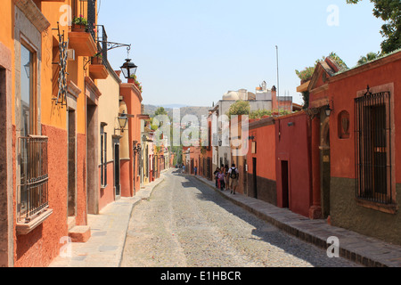 Colorful houses lining a cobbled street in San Miguel de Allende, Guanajuato, Mexico - Stock Photo