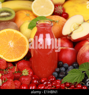 Freshly squeezed juice from red fruits such as apples, cherries and strawberries in a bottle - Stock Photo