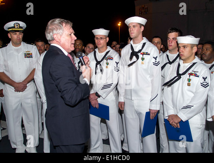 Secretary of the Navy Ray Mabus, second from left, speaks with U.S. Sailors during an all-hands call aboard the - Stock Photo