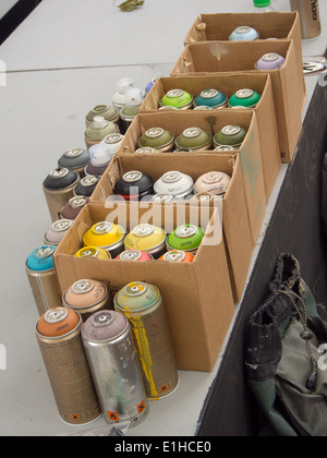 Boxes of spray paint ready to be used by a graffiti artist - Stock Photo