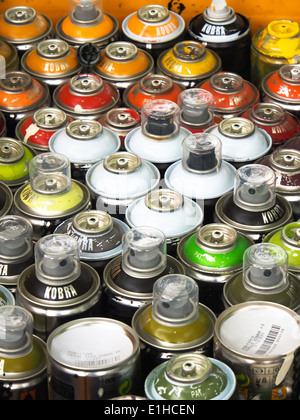 spray paint cans ready to be used by a graffiti artist - Stock Photo