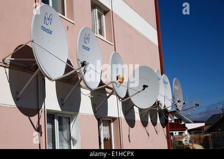 TV satellite dishes mounted on exterior of apartment building Stock ...