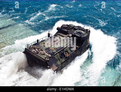 A U.S. Marine Corps amphibious assault vehicle plunges into the Gulf of Thailand as it exits the well deck of the - Stock Photo