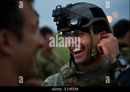 U.S. Navy Petty Officer 1st Class Kyle Jones, assigned to Explosive Ordnance Disposal Mobile Unit 11, has a laugh - Stock Photo
