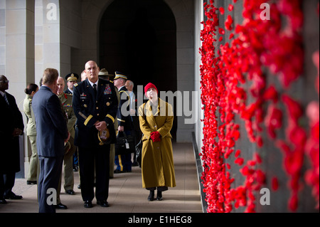 Chief of Staff of the U.S. Army Gen. Raymond T. Odierno, center foreground, looks at the poppy-adorned Roll of Honour - Stock Photo
