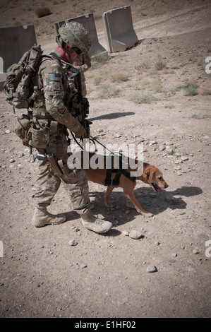 US Army dog handler Sgt. Justin McGhee gives his dog a drink of ...