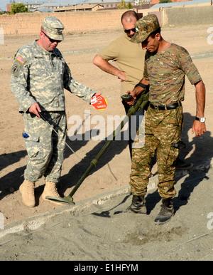 U.S. Army Sgt. 1st Class Jacob Nelson, a platoon sergeant with the Kansas National Guard, evaluates an Armenian - Stock Photo