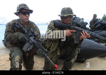 U.S. Marine Corps Sgt. Joshua Garcia, left, a squad leader with the 2nd Squad, 2nd Platoon, Fox Company, Battalion - Stock Photo
