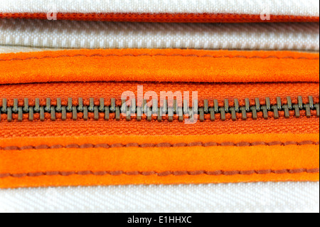 zip teeth close up on a Fossil brand shoulder bag - Stock Photo