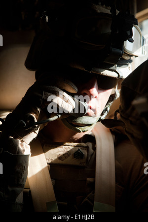 U.S. Marine Corps Sgt. Gary Wilson, a field radio operator with Motor Transportation Company, 2nd Battalion, 7th - Stock Photo