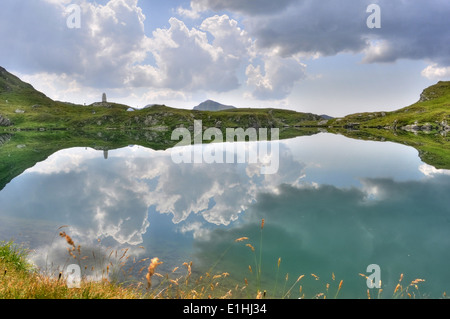Mountain lake with sky mirror, Romania, Fagaras mountain - Stock Photo