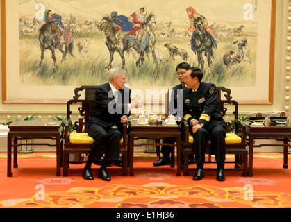 Secretary of the Navy Ray Mabus, left, meets with Chinese navy Rear Adm. Zhang Jianchang Nov. 26, 2012, in Beijing. - Stock Photo