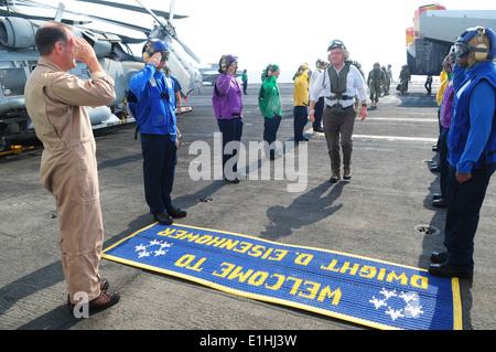 U.S. Navy Rear Adm. Michael Manazir, left, the commander of Carrier Strike Group (CSG) 8, salutes Deputy Secretary - Stock Photo