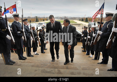 Secretary of Defense Leon E. Panetta, right, escorts Serbia's Minister of Defense Aleksandar Vucic through an honor - Stock Photo