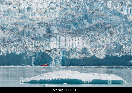 Ship in front of the Eqi Glacier, Disko Bay, West Greenland, Greenland - Stock Photo